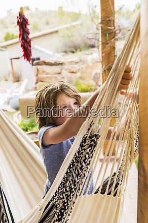 six year old boy swinging in