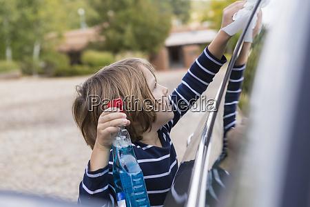 four year old boy polishing a