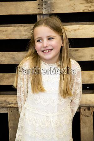 portrait of smiling girl wearing cream