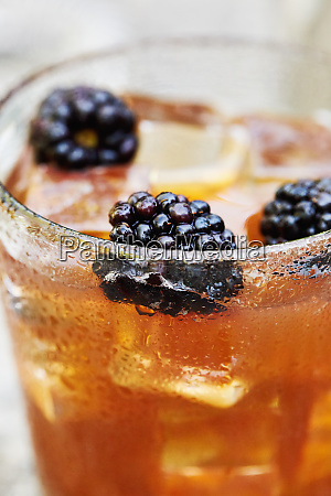 blackberries in whiskey cocktail
