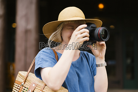 woman photographing with digital camera
