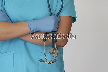 nurse with hands crossed holding stethoscope