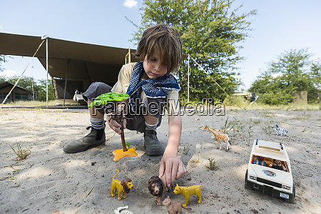 a boy setting up a safari