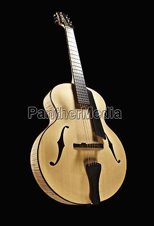 classical guitar against black