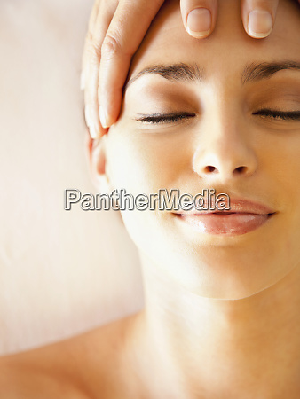 caucasian woman enjoying head massage