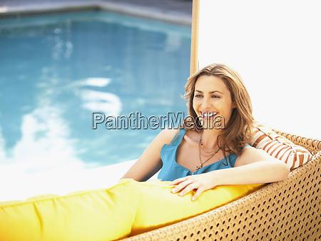 caucasian woman relaxing near swimming pool