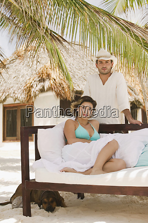 young man and woman in tropical