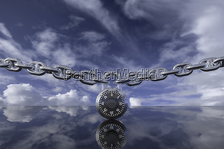 padlock with chain against clouds