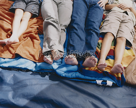 family of four people lying on