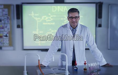 portrait male science teacher teaching dna