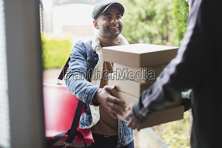 delivery man delivering pizzas at front