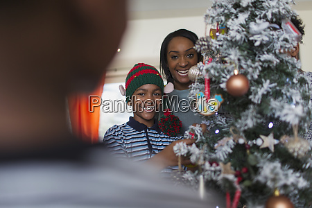 portrait happy mother and son decorating