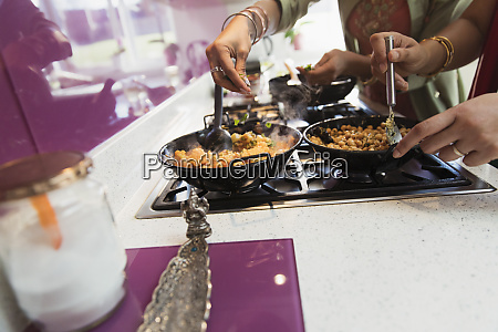indian women cooking food at stove