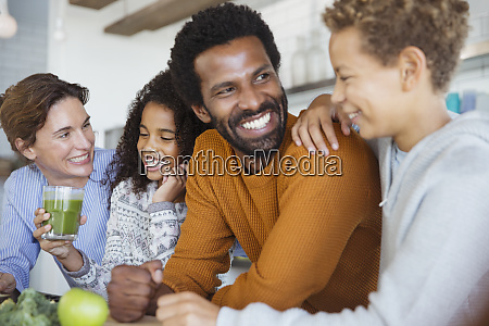 smiling multi ethnic family drinking healthy