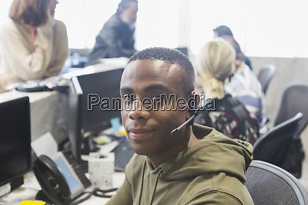 portrait confident male call center representative