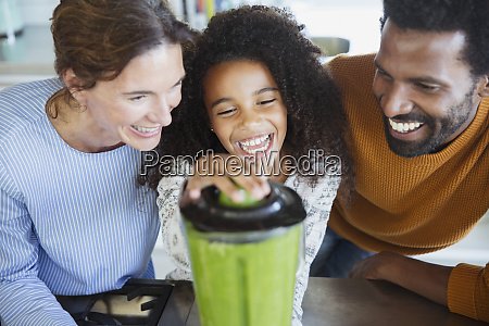 laughing multi ethnic family making healthy