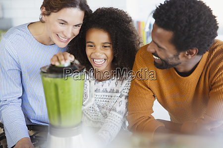 multi ethnic family making healthy green
