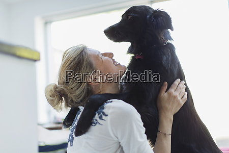 happy woman hugging dog