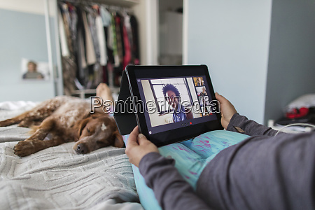 woman with digital tablet video chatting