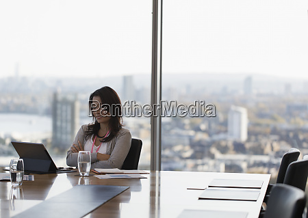 businesswoman using digital tablet in highrise