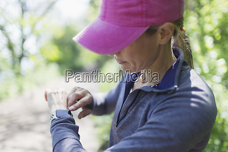 female jogger with smart watch on