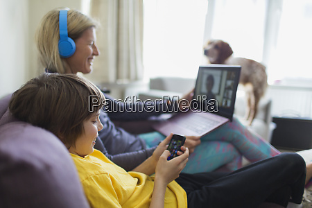 mother and son using laptop and