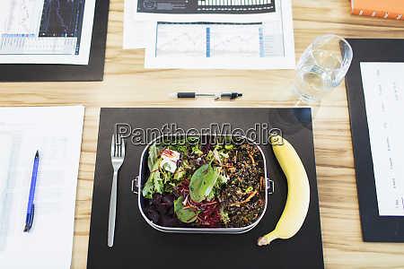 healthy salad and banana lunch on