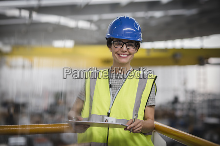 portrait smiling confident female worker with