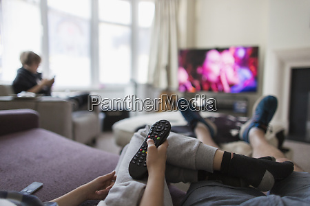 pov family with remote control watching