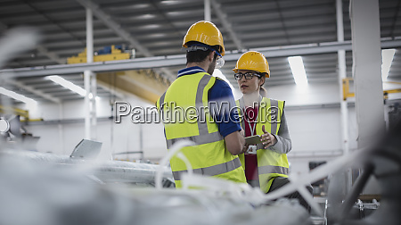 workers with digital tablet working in