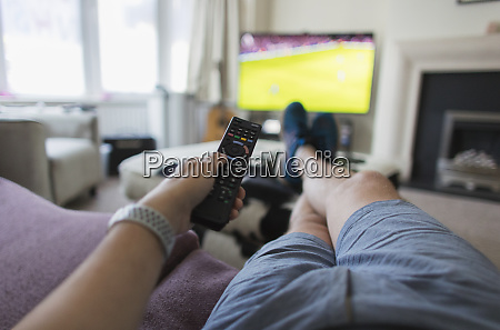 pov man with remote control watching