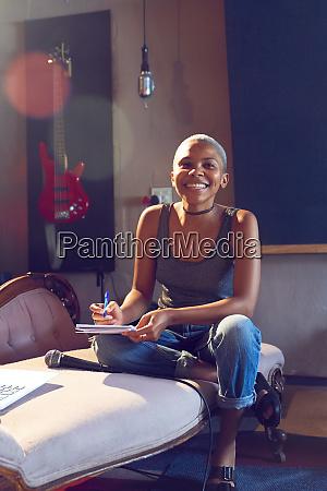portrait confident female musician song writing