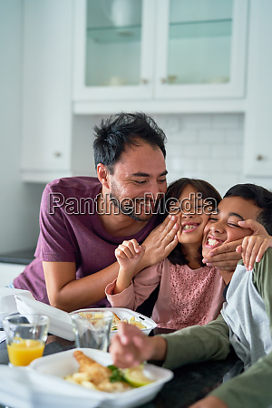 playful happy family eating take out