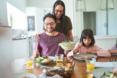 family eating at dining table