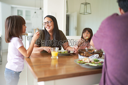 happy family eating lunch at table