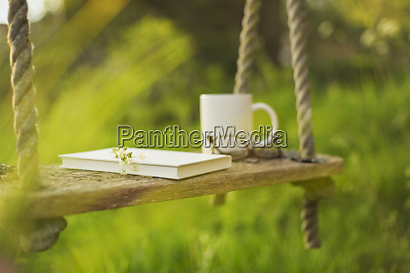 book coffee and eyeglasses on rustic