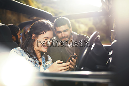 young couple checking gps on smart