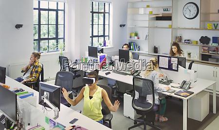 designers working at desks in open