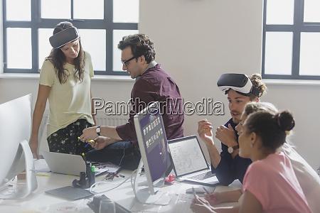 computer programmers programming virtual reality simulator