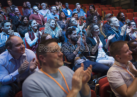 audience clapping enjoying conference