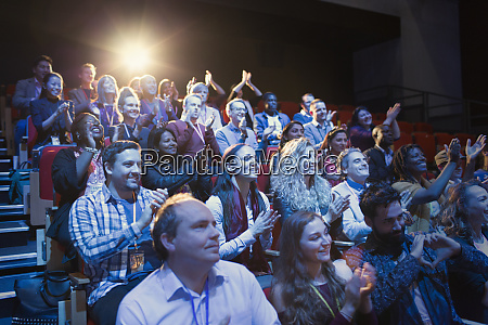 conference audience clapping
