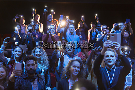 eager audience with smart phone flashlights