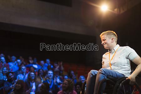 smiling female speaker in wheelchair on