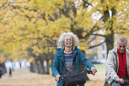 smiling carefree senior woman bike riding
