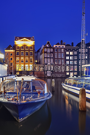 netherlands north holland amsterdam tourboats moored