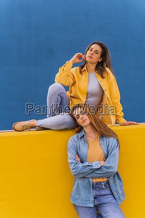 young women on an orange wall