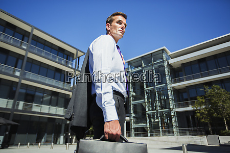businessman outside building
