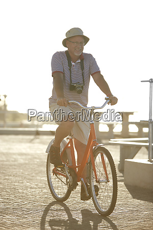 active senior man tourist bike riding