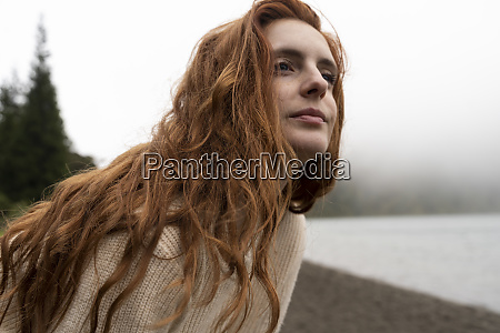 thoughtful woman with redhead looking away