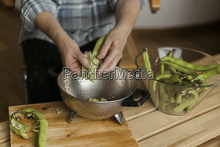 crop view of senior woman peeling